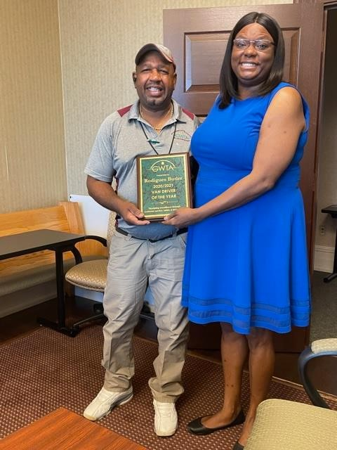 Rodigues Butler receiving award from GWTA Chairman Shycole Simpson-Carter